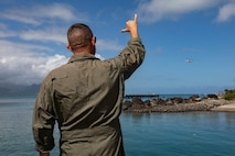 U.S. Marine Corps Lt. Col. Brian Clifton, commanding officer, Marine Medium Tiltrotor Squadron (VMM) 363, greets an MV-22B Osprey aircraft with a shaka prior to Rescue Hoist Training, Marine Corps Base Hawaii, Jan. 24, 2019. The purpose of this training is to enhance evacuation capabilities of personnel utilizing the MV-22B Osprey in the event of a military or civilian mishap at sea. The ability to hoist stranded individuals from the water with tiltrotor aircraft provides additional life-saving response options for Hawaii-based Marine's and the III Marine Expeditionary Force. (U.S. Marine Corps photo by Sgt. Jesus Sepulveda Torres)