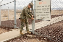 Noncommissioned Officer of the Quarter Cpl. Justin J. Zavala unlocks the gate surrounding the armory aboard Marine Corps Logistics Base Barstow, Calif, Jan. 15. As armory chief, Zavala must ensure each weapon is in working order. His dedication to his job and the best practices he has instituted at the armory are part of the reason he was chosen as NCO of the Quarter.