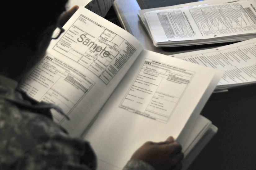 A service members looks at tax forms.