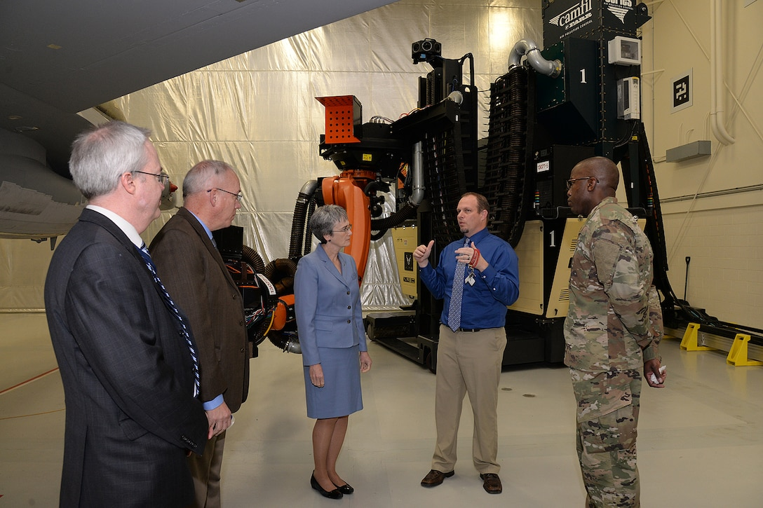Richard Crowther, 309th Aircraft Maintenance Group engineer, briefs Air Force Secretary Heather Wilson on the F-16 laser depaint system during a base visit Jan. 24, 2019, at Hill Air Force Base, Utah. The 309th AMXG is part of the Ogden Air Logistics Complex at Hill AFB, which is responsible for depot maintenance, repair, overhaul and modification of the A-10, C-130, T-38, F-16, F-22, F-35 and the Minuteman III Intercontinental Ballistic Missile system. (U.S. Air Force photo by Alex R. Lloyd)