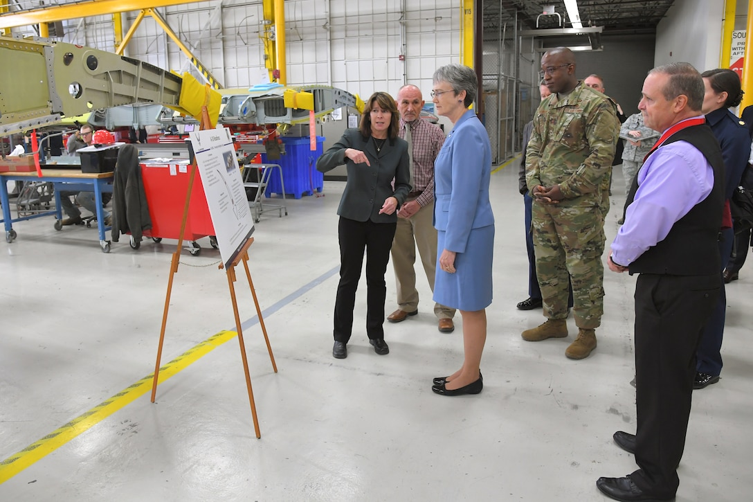Dawn Sutton, A-10 program manager, discusses A-10 Thunderbolt II readiness and sustainment with Air Force Secretary Heather Wilson during a base visit, Jan. 24, 2019, at Hill Air Force Base, Utah. (U.S. Air Force photo by Todd Cromar)