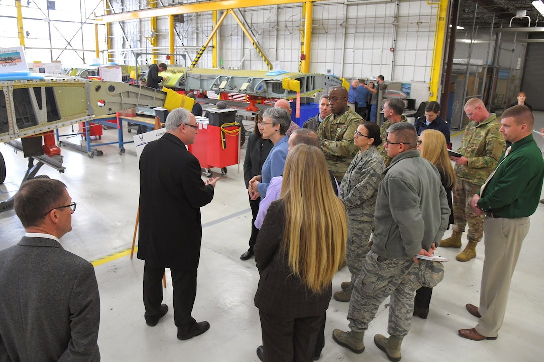 Michael Hackett, A-10 chief Engineer, discusses A-10 Thunderbolt II readiness and sustainment with Air Force Secretary Heather Wilson during a base visit, Jan. 24, 2019, at Hill Air Force Base, Utah. (U.S. Air Force photo by Todd Cromar)
