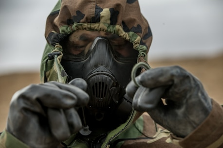 U.S. Marine Corps Cpl. Ramon Trevino, an infantry Marine with 1st Battalion, 5th Marine Regiment, participates in a decontamination drill during Steel Knight 2019 (SK19) on Marine Corps Air Ground Combat Center, Twentynine Palms, Calif., Dec. 06, 2018.