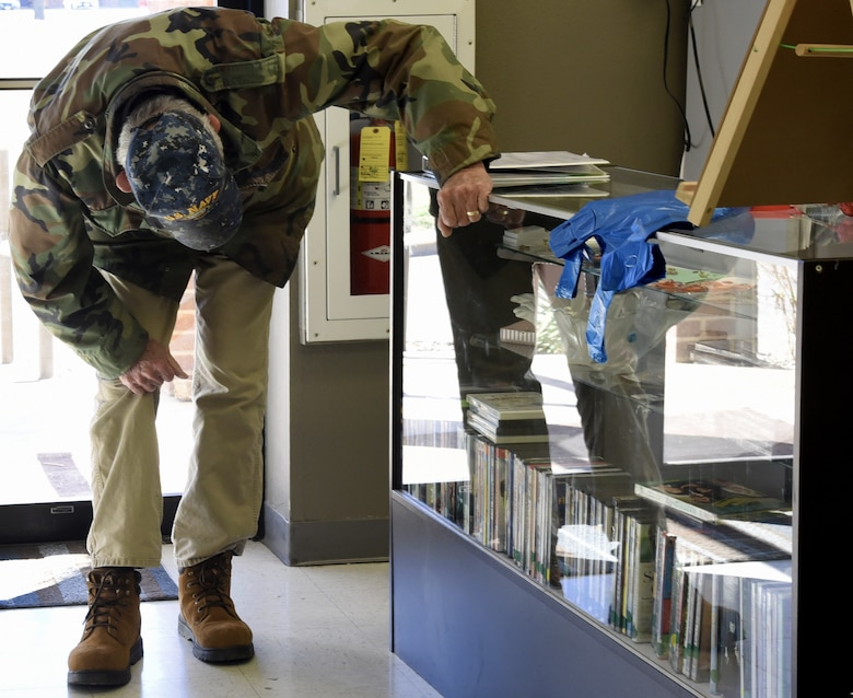 Jack Farris, a retired military veteran views the new products inside the glass case at the Goodfellow Spouses' Club Thrift Store on Goodfellow Air Force Base, Jan. 19, 2019. Farris and his wife regularly come to the thrift store on Saturdays.  (U.S. Air Force photo by Airman 1st Class Abbey Rieves/Released)
