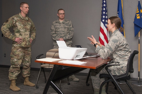 From left, Master Sgt. Jesse Pavelka, 8th Space Warning Squadron, Master Sgt. Scott Heathcoat, 310th Space Wing and Capt. Erin Couitt, 310th SW Mission Support Group, simulate a first sergeant scenario during an Air Force Reserve Additional Duty First Sergeant Symposium, Jan. 15, 2019, at Peterson Air Force Base, Colorado.