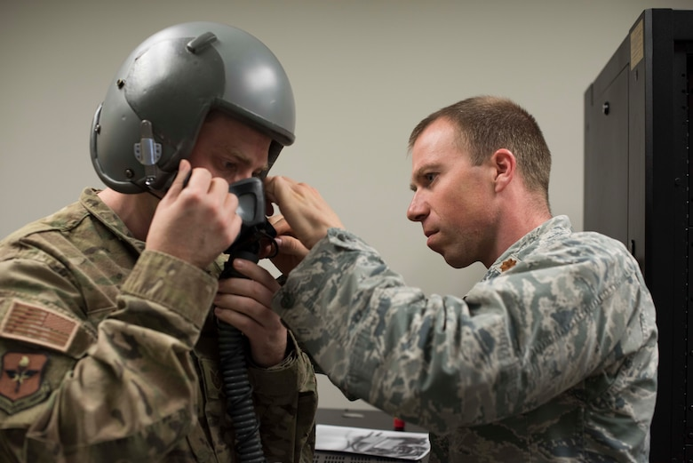 Maj. Zachary Garrett, 49th Medical Group Human Performance flight commander, fits a mask for Tech. Sgt. Jonathan Andrew, 49th MDG Education and Training flight chief, Jan. 11, 2019, on Holloman Air Force Base, N.M. As an aerospace physiologist, Garrett conducts hypoxia recognition and recovery training and studies human factors in the flight environment for 49th Wing aircrew. (U.S. Air Force photo by Staff Sgt. BreeAnn Sachs)