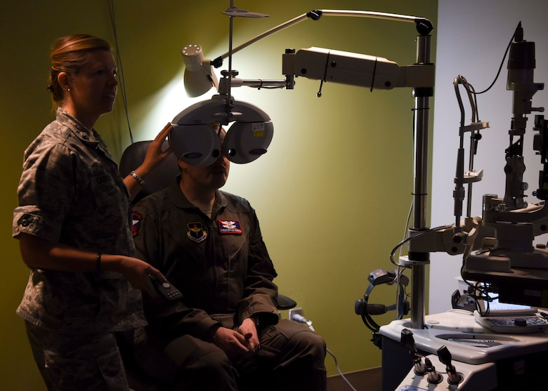 Lt. Col. Jennifer Carver, 49th Medical Group optometrist, conducts a vision exam for Maj. Christopher Vance, 9th Attack Squadron instructor pilot, Jan. 23, 2019, on Holloman Air Force Base, N.M. The 49th MDG Optometry Clinic's primary mission is to perform annual eye exams for the base community, as well as screenings for diabetics and fittings for glasses and contact lenses. (U.S. Air Force photo by Staff Sgt. BreeAnn Sachs)