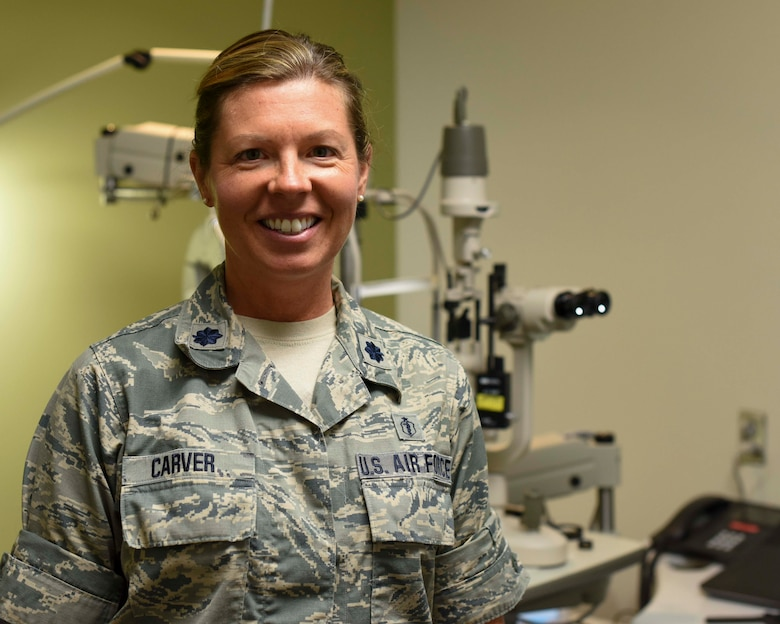 Lt. Col. Jennifer Carver, 49th Medical Group optometrist, poses in the Optometry Clinic, Jan. 23, 2019, on Holloman Air Force Base, N.M. The 49th MDG Optometry Clinic's primary mission is to perform annual eye exams for the base community, as well as screenings for diabetics and fittings for glasses and contact lenses. (U.S. Air Force photo by Staff Sgt. BreeAnn Sachs)