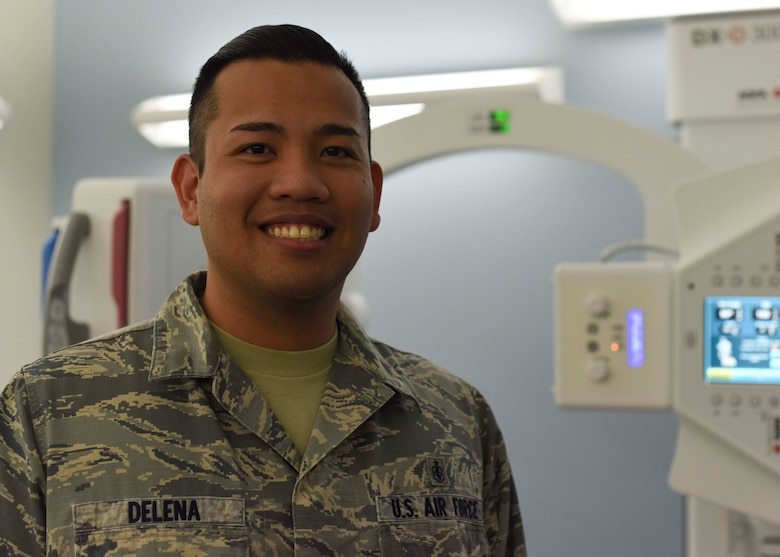 Staff Sgt. Englebert Delena, 49th Medical Group diagnostic imaging technologist, poses in front of a direct capture x-ray machine, Jan. 23, 2019, on Holloman Air Force Base, N.M. Delena is one of three diagnostic imaging technologists in the Radiology Clinic, who assists up to 2,000 patients annually. (U.S. Air Force photo by Staff Sgt. BreeAnn Sachs)
