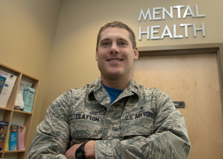 Maj. Spencer Clayton, 49th MDG Mental Health flight commander, poses outside the Mental Health clinic, Jan. 14, 2019, on Holloman Air Force Base, N.M. Mental Health staff are responsible for the overall mental well-being of Airmen across the base, and they work to keep Airmen fit to complete the mission, as well as live a happy life. (U.S. Air Force photo by Staff Sgt. Timothy Young)