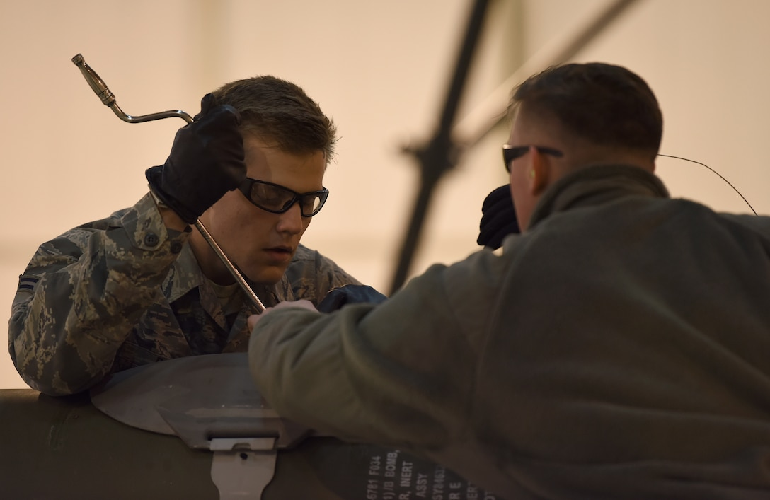 Airman 1st Class Cody Roach, 48th Munitions Squadron specialist, secures the hardback assembly on an inert ordnance at Royal Air Force Lakenheath, England, Jan. 23, 2019. Participants were hand selected by section noncommissioned officers in charge and shop chiefs to represent the squadron. (U.S. Air Force photo by Airman 1st Class Madeline Herzog)