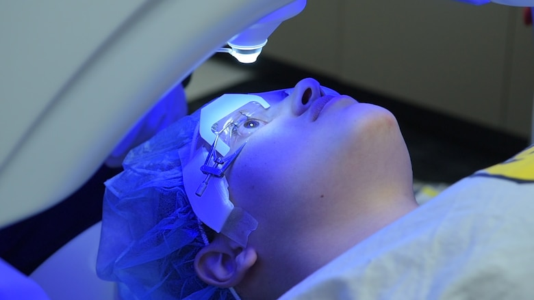 A patient receives small incision lenticule extraction treatment at the Joint Warfighter Refractive Surgery Center, Wilford Hall Ambulatory Surgical Center, Jan. 15, 2019. SMILE treatment is one of three laser surgeries performed to enhance a warfighter's vision. Surgeons at WHASC Joint Warfighter Refractive Surgery Center executed the center's 50,000th surgery since its opening in 2000. (U.S. Air Force photo by Airman 1st Class Ryan Mancuso)