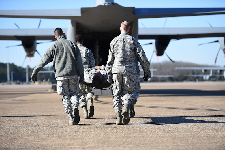 Airmen from the 19th Medical Group litter-carry a simulated patient onto a C-130J during an aeromedical evacuation training mission at Little Rock Air Force Base, Ark., Jan. 24, 2019. The training provided 19th MDG Airmen with hands-on training of airlift and aeromedical evacuation tactics, supporting rapid global mobility to respond to humanitarian or wartime requests to safeguard lives. (U.S. Air Force photo by Staff Sgt. Dana J. Cable)