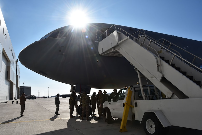 Airman from the 931st Aircraft Maintenance and 22nd Aircraft Maintenace squadron, unload the first KC-46A Pegasus delivered to McConnell during  an official arrival ceremony, Jan. 25, 2019, McConnell Air Force Base, Kan.