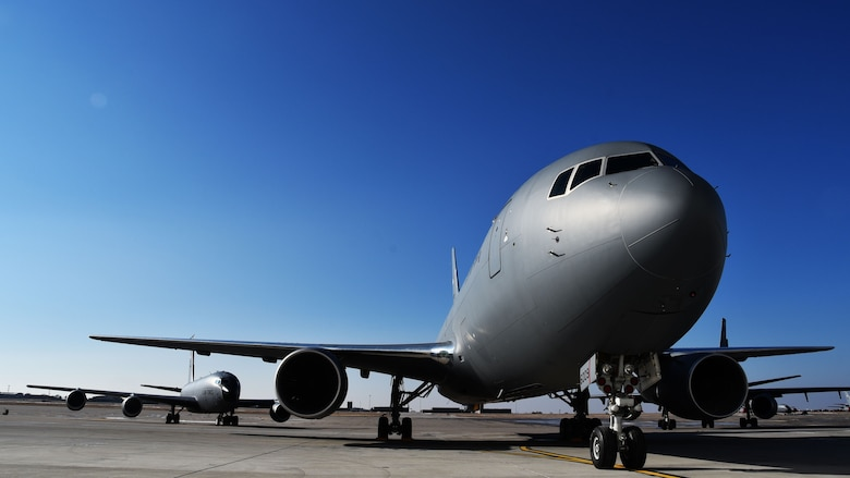 The first KC-46A Pegasus delivered to Team McConnell, sits on the flightline with a KC-135 Stratotanker close behind it, Jan. 25, 2019, McConnell Air Force Base, Kan. McConnell received two KC-46As, the next generation in air refueling aircraft.
