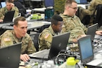 U.S. Army Sgt. Brandon Miller (left), Pfc. Karl Powell (middle)  and Cpl. Alexander Bishop (right), monitor simulated disaster data in the web-based Common Operational Picture at the Joint Task Force Civil Support (JTF-CS) Joint Operations Center during Exercise Sudden Response 19 in Fayetteville, N.C., on January 26, 2019. Miller and Powell are geospatial engineers with the 543rd geospatial planning cell, and Bishop is multisystem channel maintainer with the 76th operational response command. (Official DoD photo by Staff. Sgt. Jeramy Moore/released)