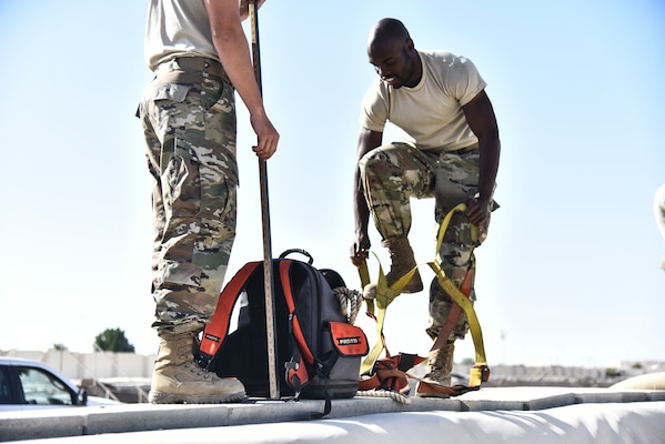 U.S. Air Force Senior Airman Lavert Octetree, 380th Expeditionary Logistics Readiness Squadron fuels operations technician, dons a harness before entering a fuel bladder dike at Al Dhafra Air Base, United Arab Emirates, Jan. 21, 2019. The 380th Expeditionary Logistics Readiness Squadron Fuels Flight also known as Petroleum, Oil and Lubricant's flight, provides, stores, tests and distributes fuel – the bread and butter of Al Dhafra Air Base, United Arab Emirates. (U.S. Air Force photo by Senior Airman Mya M. Crosby)