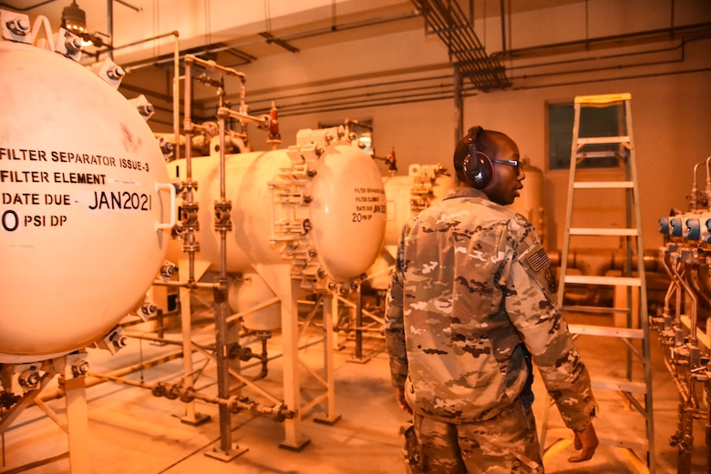U.S. Air Force Senior Airman Melvin Tucker, 380th Expeditionary Logistics Readiness Squadron fuels storage technician, inspects Bubba, a Type-3 hydrant system, at Al Dhafra Air Base, United Arab Emirates, Jan. 21, 2019. Tucker is one of the many Airmen responsible for operating the hydrant system that monitors and controls the fuel from the storage tanks all the way to the flight line and into the aircraft. (U.S. Air Force photo by Senior Airman Mya M. Crosby)