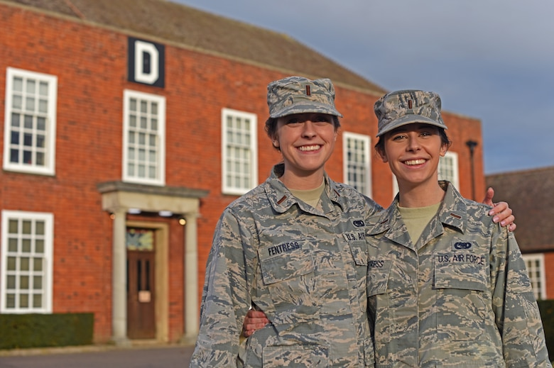 U.S. Air Force 2nd Lt. Reagan Fentress, left, 100th Logistics Readiness Squadron Deployment and Distribution flight commander, and U.S. Air Force 2nd Lt. Blythe Fentress, 727th Air Mobility Squadron Air Terminal Operations Center Officer-in-charge, pose for a photo at RAF Mildenhall, England, Jan. 8, 2019. Reagan attended the U.S. Air Force Academy, while Blythe commissioned after attending the U.S. Merchant Marine Academy in New York.  (U.S. Air Force photo by Airman 1st Class Brandon Esau)