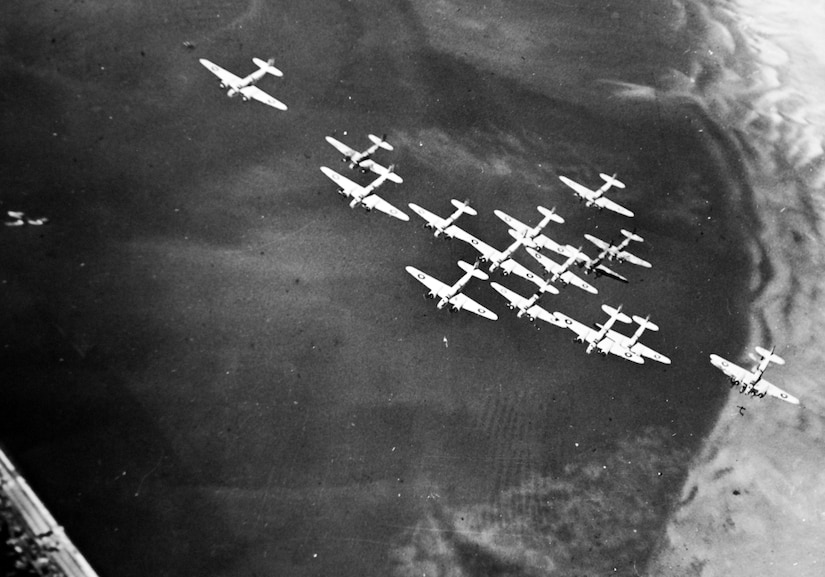 "Glenn Martin A-22 ""Maryland"" bombers flown by South African Air Force in striking ""tight box"" formation on way to raid enemy harbors during North African Campaign (U.S. Office of War Information)"