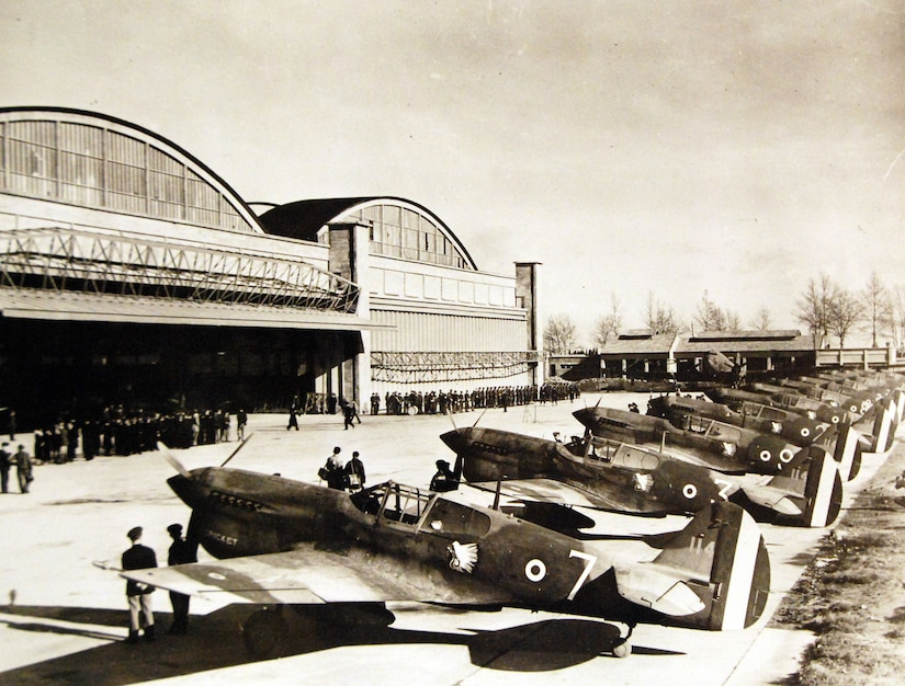 "Line-up of 13 P-40 ""Warhawk"" aircraft presented by United States to Fighting French air forces at North African airport, circa 1943 (U.S. Office of War Information)"