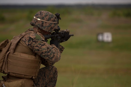 A Marine sights in on a target during a combat marksmanship program at Camp Lejeune, N.C., Aug 31, 2017. The Marines took part in the routine qualification training to maintain their combat skills for mission readiness. The Marine is with 2nd Light Armored Reconnaissance Battalion. (U.S. Marine Corps photo by Pfc. Nicholas Guevara)
