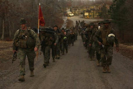 U.S. Marines with Alpha Company, 1st Battalion, 2nd Marine Regiment, 2nd Marine Division, hike back to their quarters after a house clearing range as part of a deployment for training exercise at Fort Pickett, Va., Feb. 23, 2018. The range provided Marines the opportunity to improve maneuver tactics, and work with fire teams in close quarter movements. The DFT refines collective warfighting skills and functions in order to prepare for future combat operations. (U.S. Marine Corps Photo by Pfc. Heather Atherton)