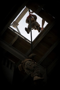 U.S. Marines and Sailors with Alpha company, 1st Battalion, 2nd Marine Regiment, 2nd Marine Division, participate in fast rope training at Camp Lejeune, N.C., April 26, 2018. Each Marine rappelled with packs and a combat load to simulate real life scenarios in preparation for an upcoming deployment with 22nd Marine Expeditionary Unit. (U.S. Marine Corps photo by Lance Cpl. Caleb T. Maher)