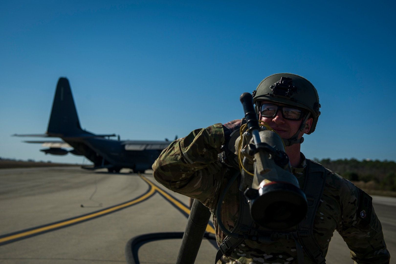 Airman with 1st Special Operations Logistic Readiness Squadron conducts forward area refueling point operation at Hurlburt Field, Florida, February 26, 2017 (U.S. Air Force/Joseph Pick)