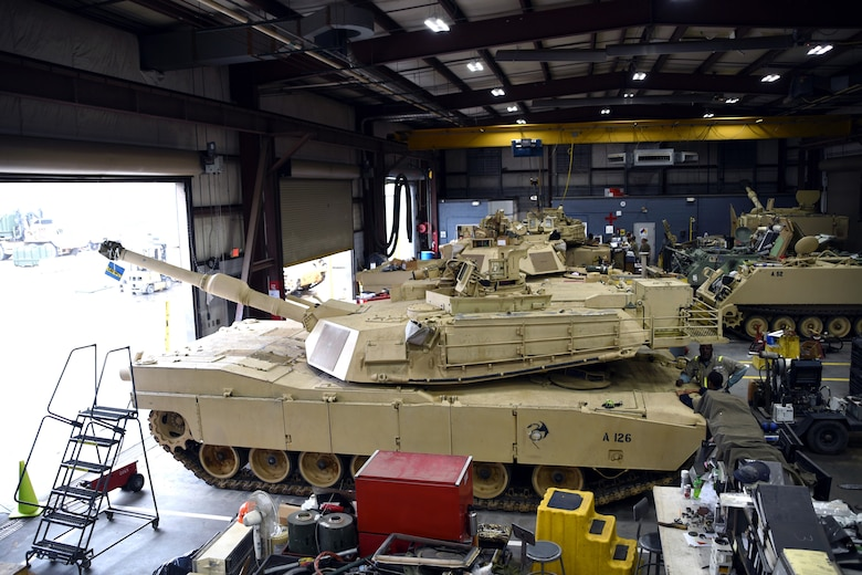 M1 Abrams tanks and other tracked vehicles sit in the maintenance bay at the South Carolina National Guard Unit Training Equipment Site on McCrady Training Center in Eastover, South Carolina, Jan. 23, 2019. Vehicle maintenance and repairs in the National Guard often falls to dual-status technicians - federal civilian employees who are required to maintain membership in a Guard unit as part of their employment. Technicians are also required to wear their military uniform and adhere to military customs and courtesies while on duty. This month marks the 50-year anniversary of the technician program, which came into being Jan. 1, 1969.