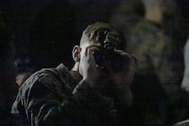 A Marine peers through the lens of the Squad Binocular Night Vision Goggles during new equipment training in December 2018 at Camp Lejeune, North Carolina. The move to the SNBVG is expected to enhance the infantry's lethality and situational awareness in reduced visibility