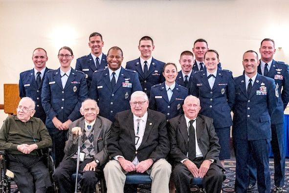 This group photo was taken October 13, 2018 in the officers' lounge at Joint Base Andrews, Maryland, to mark the reunion of the 490th of yesterday and today. From left to right starting in the back are Capt. Tony Ferrelli, Lt. Ariana Henry, Lt. Mitch Nairn, Maj. Chris Boney, Senior Airman Todd Conley, Lt. Kyla Thrasher, Capt. Ryan Potts, Maj. Marc Keller, Lt. Kinsey Richmond, Master Sgt. Matthew Manning, Lt. Col. Troy Stauter. The front row from left to right are retired Maj. Charles Good, retired Staff Sgt. Murry Schenker, Joe Barrett and Tom Bristol. (Photo courtesy Capt. Tony Ferrelli)