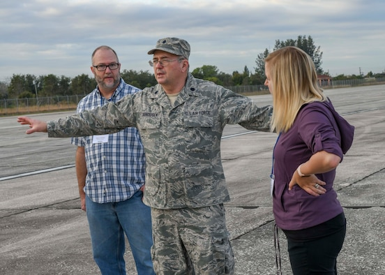 Lt. Col. Tom Janousek, an entomologist assigned to the 910th Airlift Wing's 757th Airlift Squadron, explains to attendees of a Department of Defense aerial spray course the techniques used during an aerial spray demonstration, Jan. 9, 2019 at the Buckingham Air Field at the Lee County Mosquito Control District facilities in Lehigh Acres, Florida.