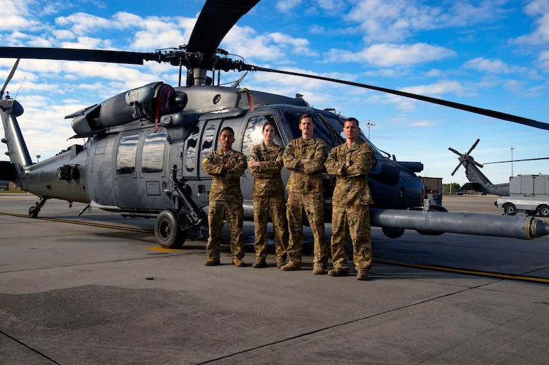 A 41st Rescue Squadron HH-60G Pave Hawk helicopter 'hard crew' poses for a photo, Jan. 11, 2019, at Moody Air Force Base, Ga. To optimally perform their Combat Search and Rescue mission downrange, the 347th Rescue Group implemented the advanced training 'hard crew' system, which unifies the 38th and 41st RQS's into separate rescue operator teams that'll fly every mission together for their upcoming deployment. This concept establishes continuity and chemistry which will help maximize the 38th and 41st RQS's mission readiness by simultaneously working together to build relationships and understand each other's idiosyncrasies, strengths, and weaknesses to ultimately improve the team's performance in mission execution. (U.S. Air Force photo by Senior Airman Greg Nash)