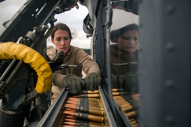 Airman 1st Class Lauren Cox, 41st Rescue Squadron (RQS) special missions aviator, loads ammunition into an M2 machine gun mount on an HH-60G Pave Hawk helicopter during routine training, Jan. 16, 2019, at Moody Air Force Base, Ga. To optimally perform their Combat Search and Rescue mission downrange, the 347th Rescue Group implemented the advanced training 'hard crew' system, which unifies the 38th and 41st RQS's into separate rescue operator teams that'll fly every mission together for their upcoming deployment. This concept establishes continuity and chemistry which will help maximize the 38th and 41st RQS's mission readiness by simultaneously working together to build relationships and understand each other's idiosyncrasies, strengths, and weaknesses to ultimately improve the team's performance in mission execution. (U.S. Air Force photo by Senior Airman Greg Nash)