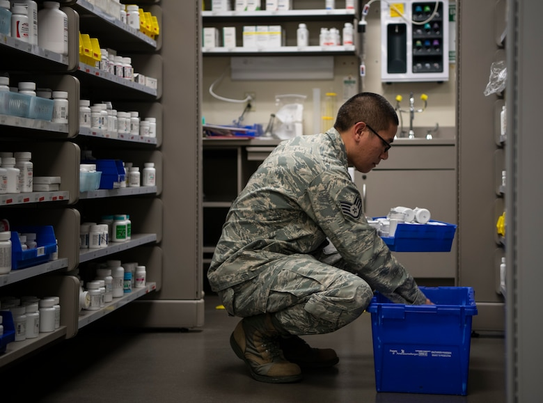 Staff Sgt. Brandtlee Maluenda, 436th Medical Group pharmacy technician, stocks the shelves with medication Jan. 22, 2019, at Dover Air Force Base, Delaware. Team Dover's pharmacy is unique in that it is primarily staffed by volunteers, including civilians. (U.S. Air Force photo by Airman 1st Class Zoe M. Wockenfuss)