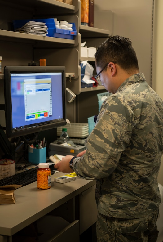 Maj. Jin Kim, 436th Medical Group pharmacy flight commander, verifies medication before giving prescriptions to patients Jan. 22, 2019, at Dover Air Force Base, Delaware. Team Dover's pharmacy is unique in that it is primarily staffed by volunteers. (U.S. Air Force photo by Airman 1st Class Zoe M. Wockenfuss)