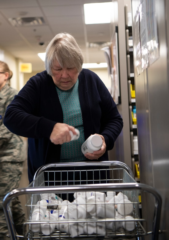 Patricia Simmons, 436th Medical Group pharmacy volunteer, sorts through medication Jan. 22, 2019, at Dover Air Force Base, Delaware. Team Dover's pharmacy is unique in that it is primarily staffed by volunteers. Simmons has been volunteering at the pharmacy for about seven years. (U.S. Air Force photo by Airman 1st Class Zoe M. Wockenfuss)