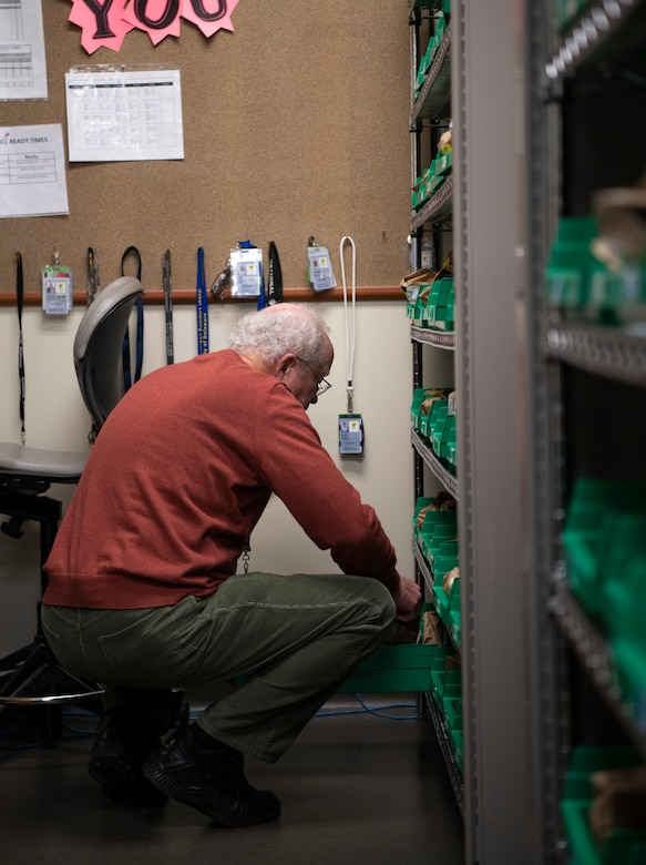 Edward O'Dell, 436th Medical Group pharmacy volunteer, finds a patient's medication Jan. 22, 2019, at Dover Air Force Base, Delaware. Team Dover's pharmacy is unique in that it is primarily staffed by volunteers. O'Dell has been volunteering at the pharmacy for approximately five years. (U.S. Air Force photo by Airman 1st Class Zoe M. Wockenfuss)