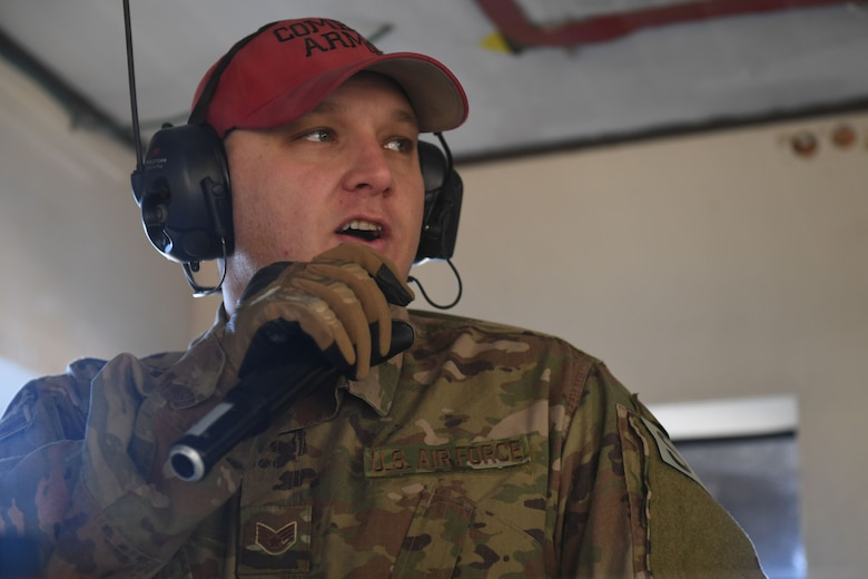 A man speaks into a microphone.