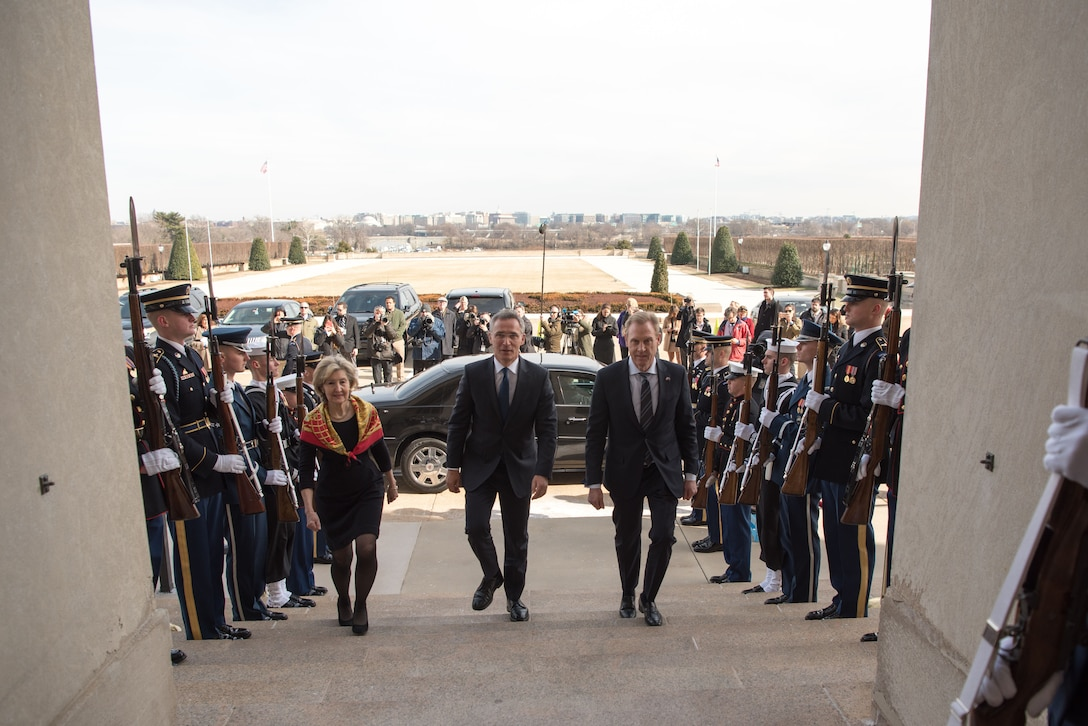 Acting defense secretary and NATO secretary general enter the Pentagon.