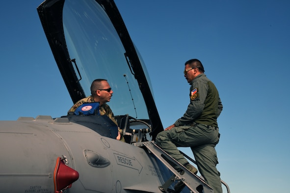 U.S. Air Force Tech Sgt. Ed Edens, 113th Maintenance Squadron Egress system mechanic, left, and Philippine Air Force Tech. Sgt. Roderick Domingo, 430th Aircraft Maintenance Group Egress system supervisor, right, perform a visual inspection of a U.S. Air Force F-16 Fighting Falcon during the Bilateral Air Contingent Exchange-Philippines (BACE-P) at Cesar Basa Air Base, Philippines, Jan. 22, 2019.
