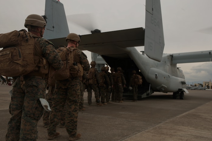 U.S. Marines with Special Purpose Marine Air-Ground Task Force- Crisis Response- Africa 19.1 board a U.S. Marine Corps MV-22 Osprey at Naval Air Station Sigonella, Italy, Jan. 11, 2019