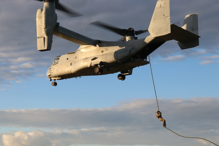 A U.S. Air Force pararescue jumper attached to Special Purpose Marine Air-Ground Task Force-Crisis Response-Africa 19.1 conducts fast-rope insertion drills from a MV-22 Osprey at Naval Air Station Sigonella, Italy, Jan. 7, 2019.