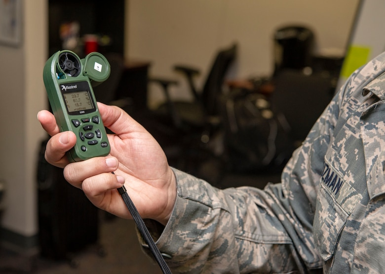 Staff Sgt. Ivan Guzman, 436th Operations Support Squadron weather forecaster, holds a weather-monitoring device Jan. 24, 2019, on Dover Air Force Base, Delaware. The device not only displays wind information but also humidity, temperature and a host of other metrics. (U.S. Air Force photo by Staff Sgt. Jared Duhon)