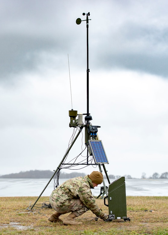 Senior Airman Aaron Cathey, 436th Operations Support Squadron weather forecaster, inspects connections of a tactical meteorological observation system Jan. 24, 2019, on Dover Air Force Base, Delaware. The equipment provides redundancy for stationary equipment around the runway and is also capable of being used in a deployed environment. (U.S. Air Force photo by Staff Sgt. Jared Duhon)