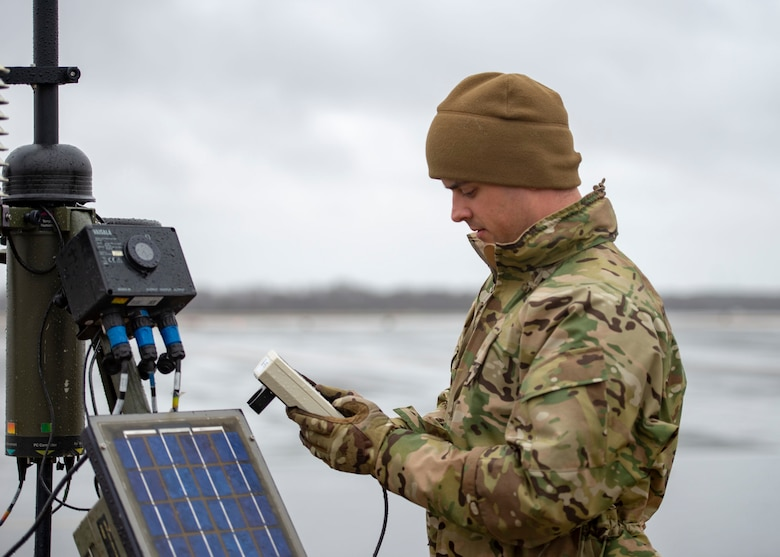 Senior Airman Aaron Cathey, 436th Operations Support Squadron weather forecaster, checks data on a tactical meteorological observation system Jan. 24, 2019, on Dover Air Force Base, Delaware. The equipment provides redundancy for stationary equipment around the runway and is also capable of being used in a deployed environment. (U.S. Air Force photo by Staff Sgt. Jared Duhon)