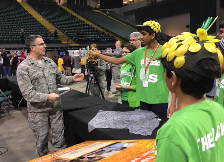 Maj. Gen.William Cooley, Air Force Research Laboratory commander, Wright-Patterson Air Force Base, explains how important it is for students to pursue STEM-related careers during the FIRST LEGO League Ohio Championship Tournament held Feb. 4, 2018, at Wright State University. (U.S.Air Force photo/Marie Vanover)