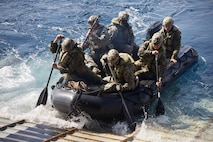 U.S. Marines with Alpha Company, Battalion Landing Team, 1st Battalion, 4th Marine Regiment, the 'China Marines,' launch a Combat Rubber Raiding Craft during a simulated boat raid aboard the dock landing ship USS Ashland (LSD 48) in the  Philippine Sea Jan. 25, 2019.