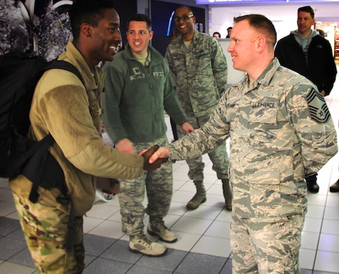 932nd Airlift Wing members welcomed back several Airmen recently, including deployer Staff Sgt. Excel Bailey.  Shaking his hand upon arrival back in Illinois on January 14, 2019, is Chief Master Sgt. Darren Wiseman of the unit's 932nd Inspector General Inspections office.  The 932nd AW is an Air Force Reserve Command unit located at Scott Air Force Base, Illinois.